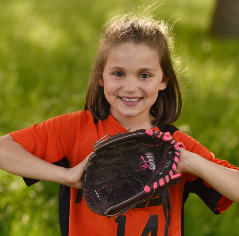 girl holding softball glove